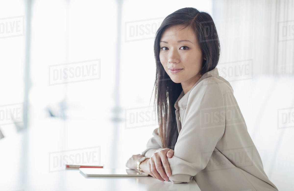 Portrait smiling businesswoman with digital tablet in conference room Royalty-free stock photo