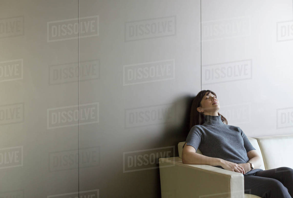 Tired businesswoman resting on sofa Royalty-free stock photo