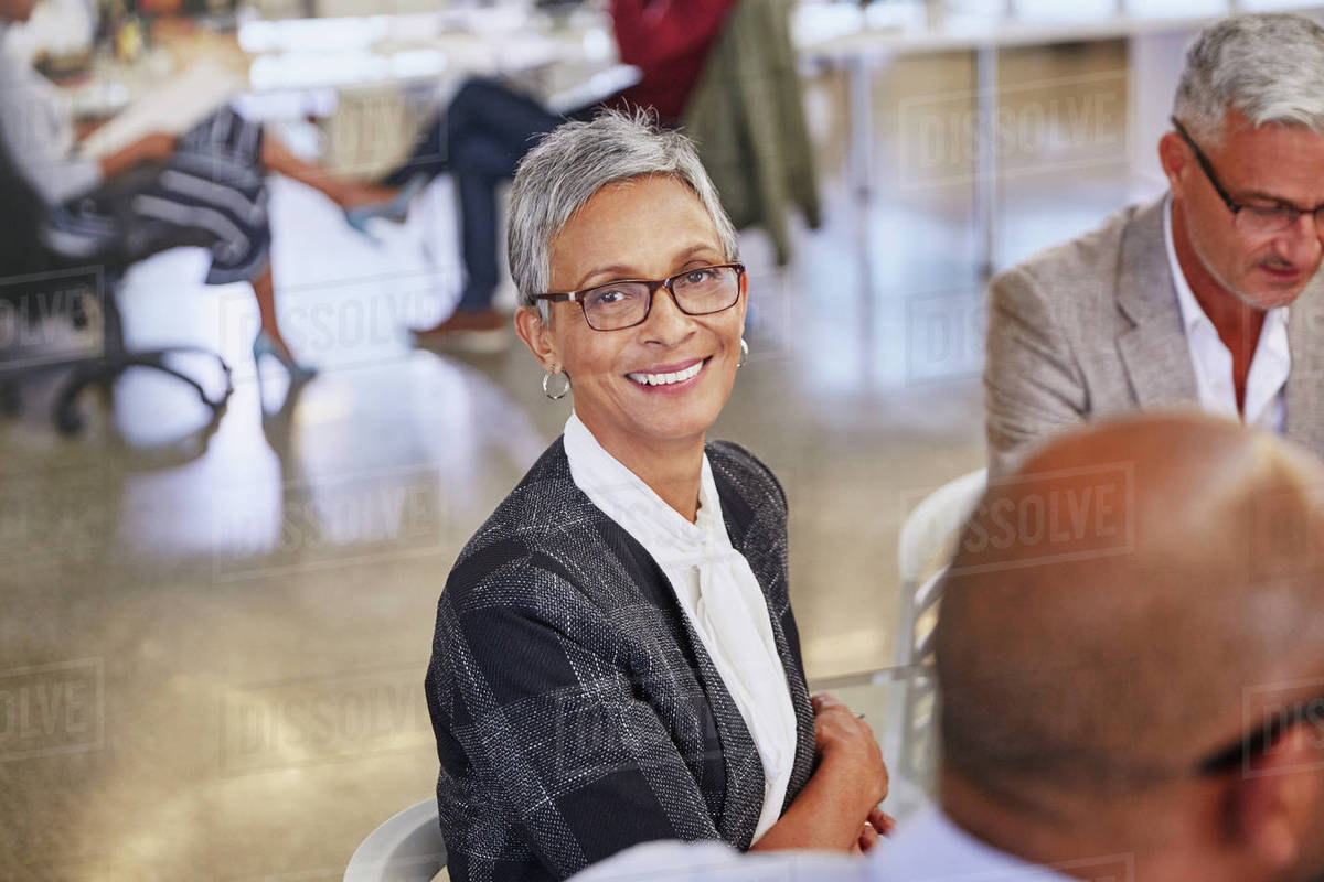 Portrait smiling businesswoman in meeting Royalty-free stock photo