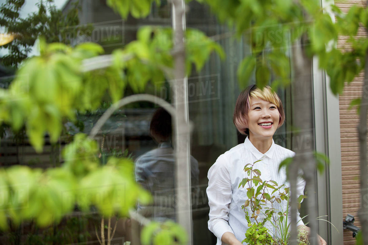 A woman standing in her garden. Royalty-free stock photo