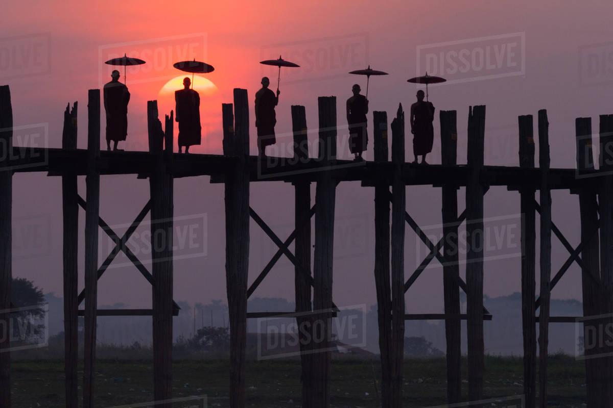 Monks on the U Bein Bridge, Amarapura, Myanmar Royalty-free stock photo