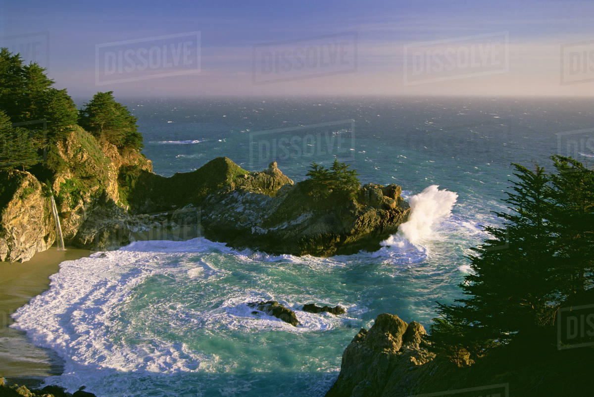 The coastline and a horseshoe bay with waves crashing against the rocks in Julia Pfeiffer Burns State Park. Royalty-free stock photo
