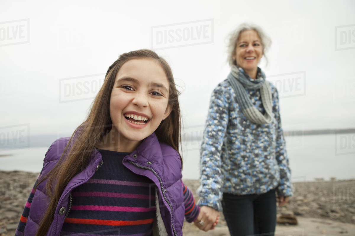 A day out at Ashokan lake. A mature woman holding hand with a young girl.  Royalty-free stock photo