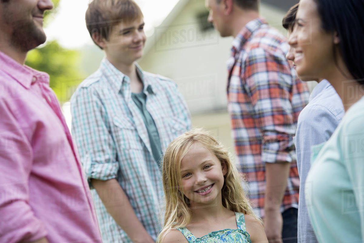 A group of people, adults and teenagers at a summer party. Royalty-free stock photo