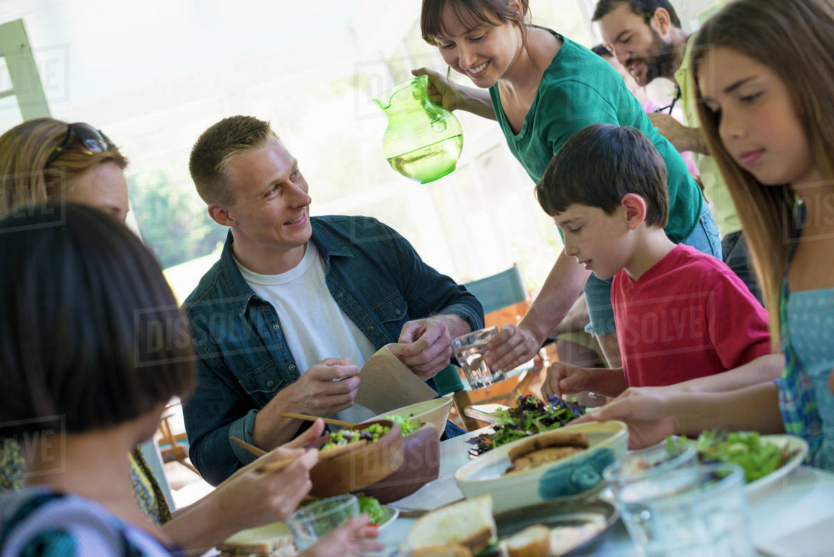 A family party around a table in a cafe. Adults and children. Royalty-free stock photo