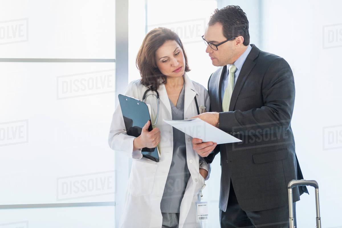 pharmaceutical representative talking to female doctor stock pharmaceutical representative talking to female doctor royalty stock photo