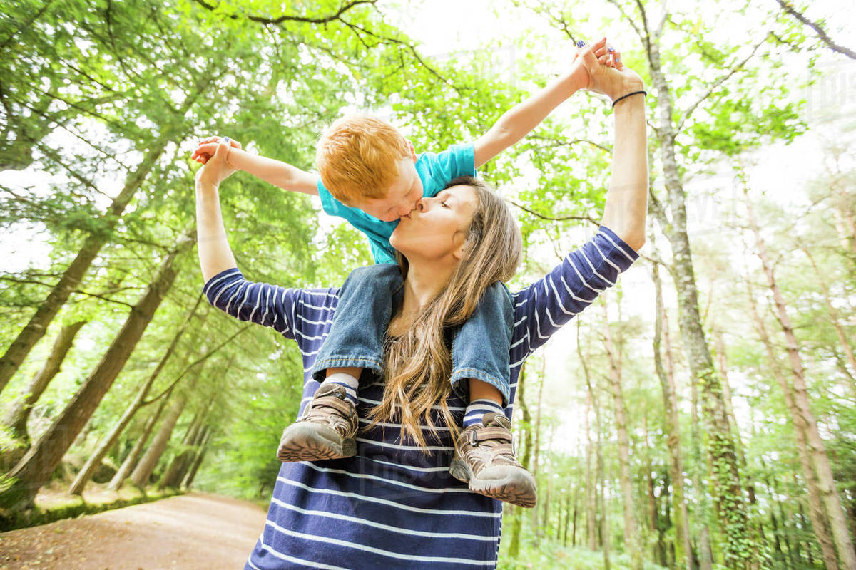 Mother carrying on shoulders son (2-3) Royalty-free stock photo