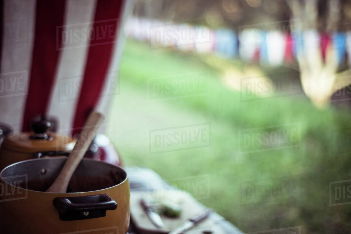 Container with spoon on table at campsite Royalty-free stock photo