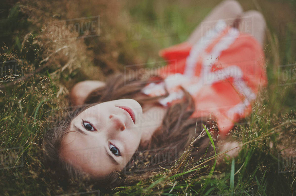 High angle portrait of girl lying on field Royalty-free stock photo