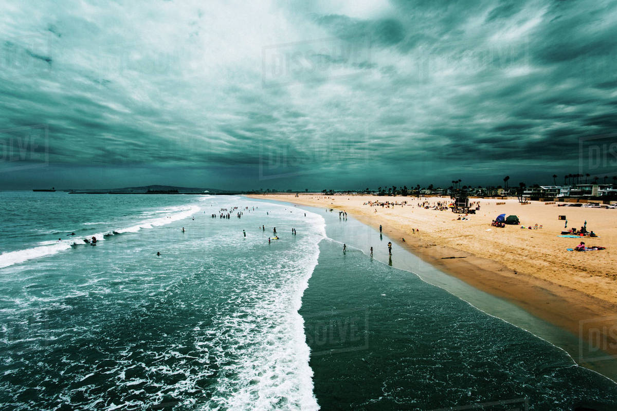 People on beach against cloudy sky Royalty-free stock photo