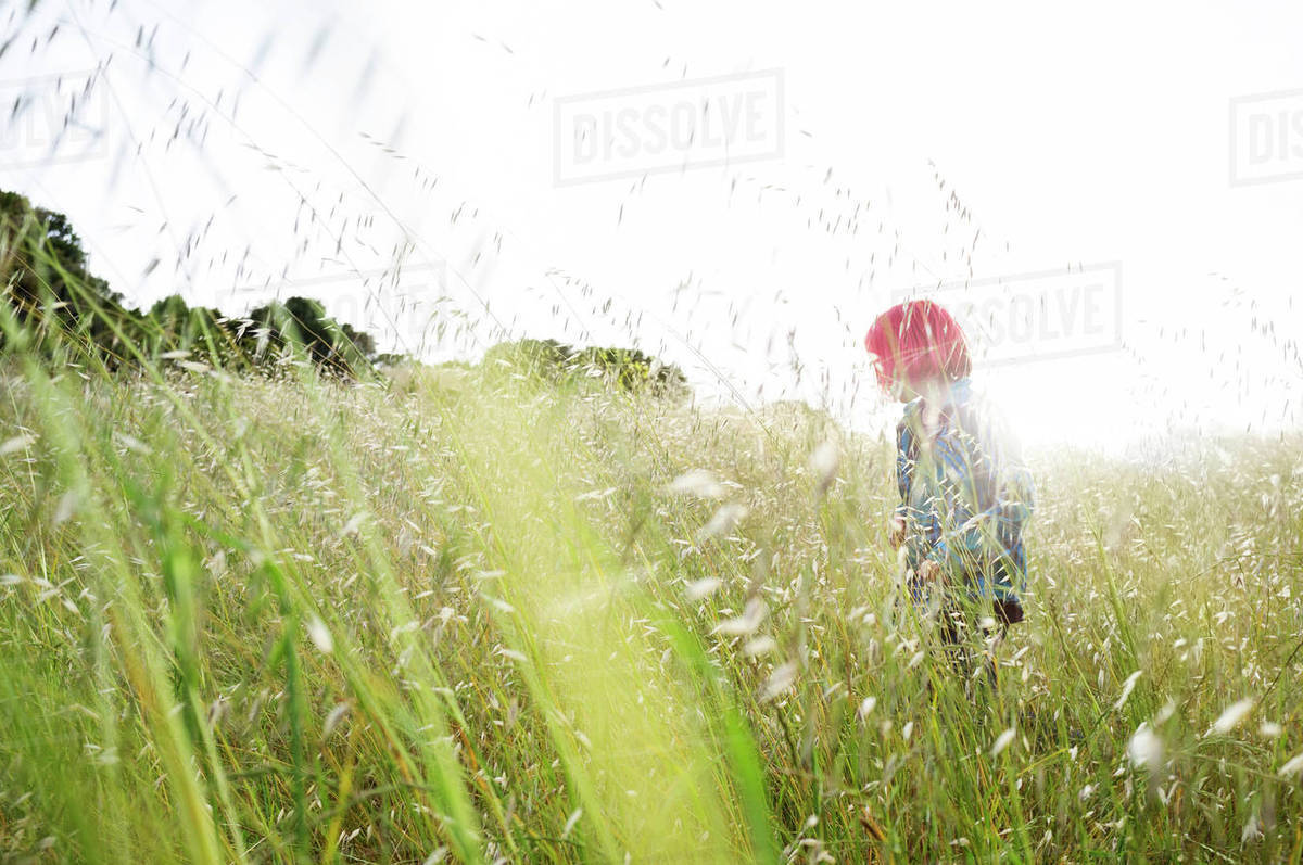Side view of boy in field against clear sky Royalty-free stock photo