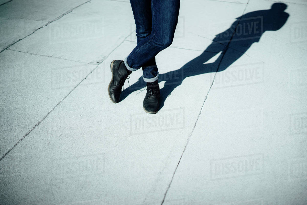 Low section of man standing on footpath Royalty-free stock photo