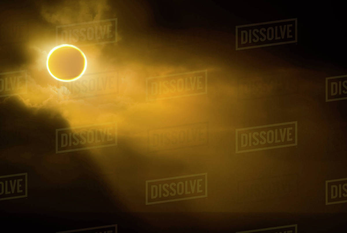 Low angle view of solar eclipse in sky during foggy weather Royalty-free stock photo
