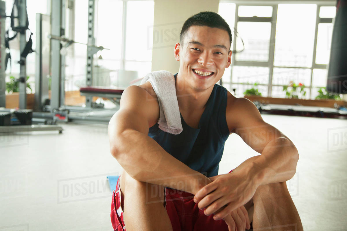 Young man sitting in the gym, portrait Royalty-free stock photo