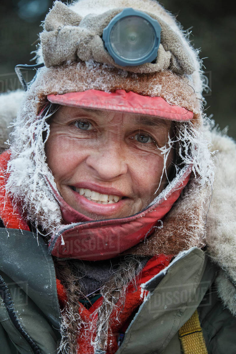 Marcelle Fressineau is frosted up after her ride into Rohn during Iditarod 2014. Rights-managed stock photo