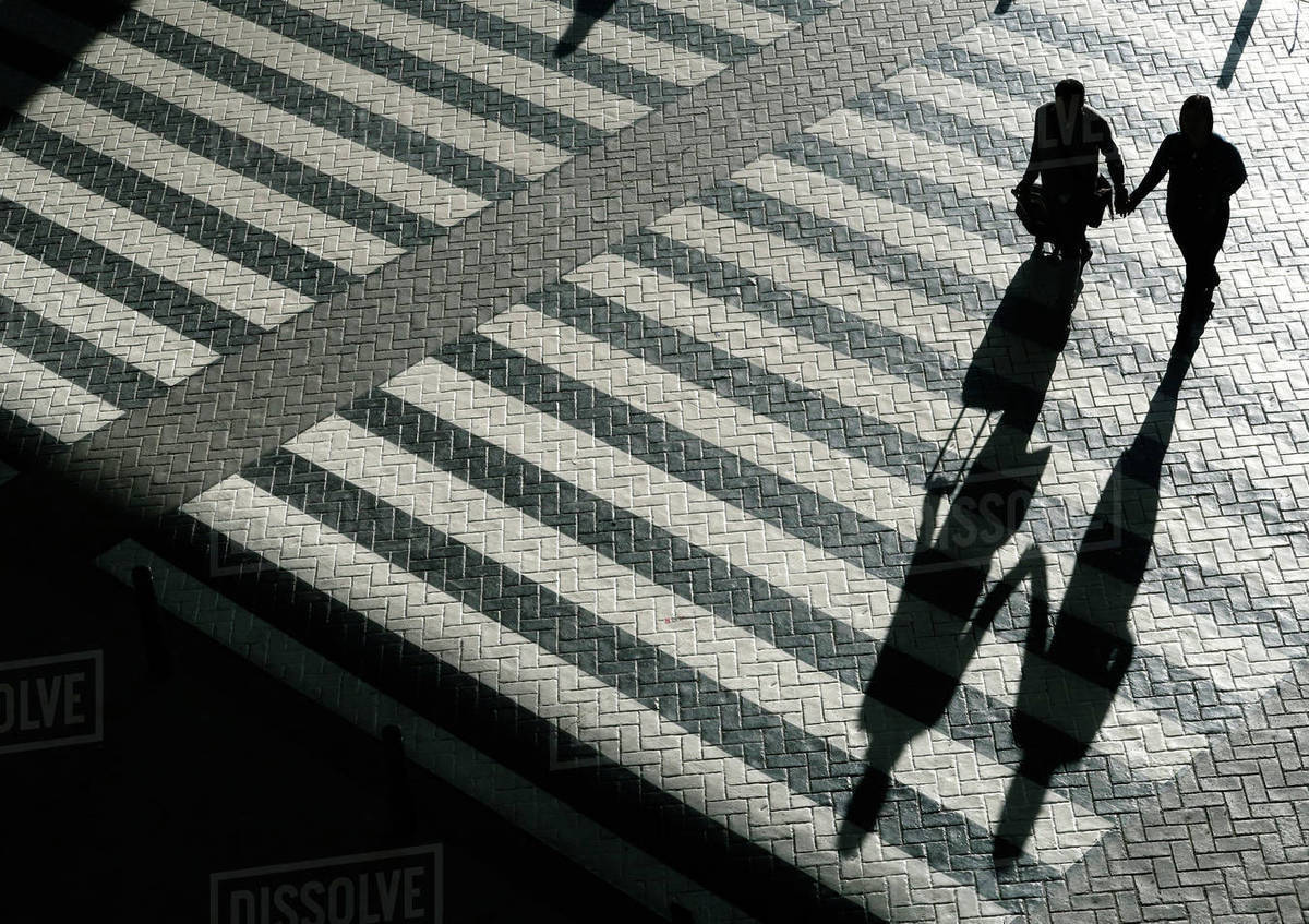 High angle view of silhouette people crossing road Royalty-free stock photo
