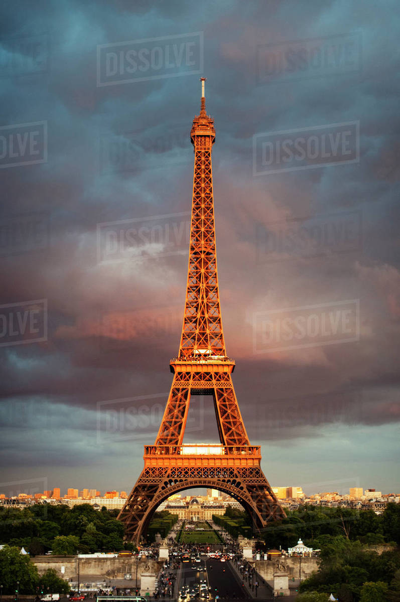 Low angle view of Eiffel Tower against cloudy sky during sunset Royalty-free stock photo