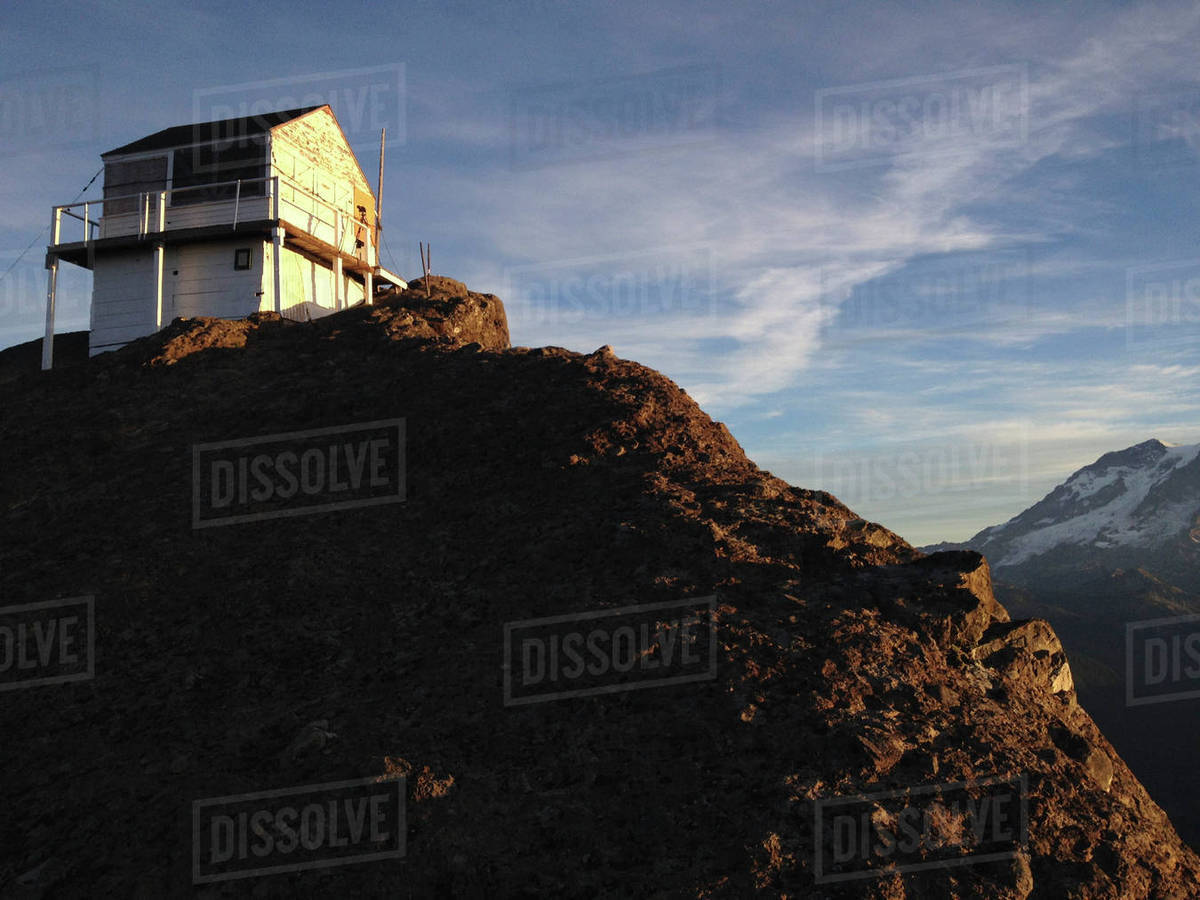Low angle view of house on mountain against sky Royalty-free stock photo