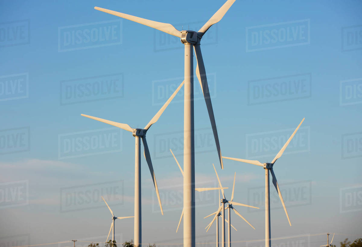Windmills against blue sky Royalty-free stock photo