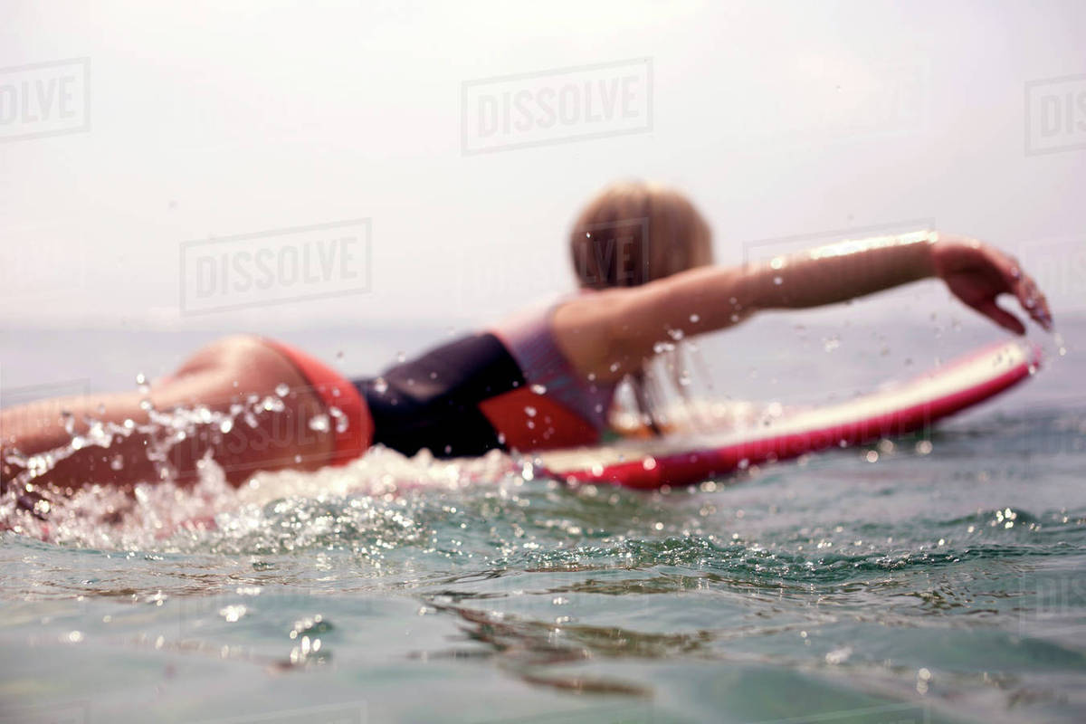 Woman surfing in sea against sky Royalty-free stock photo