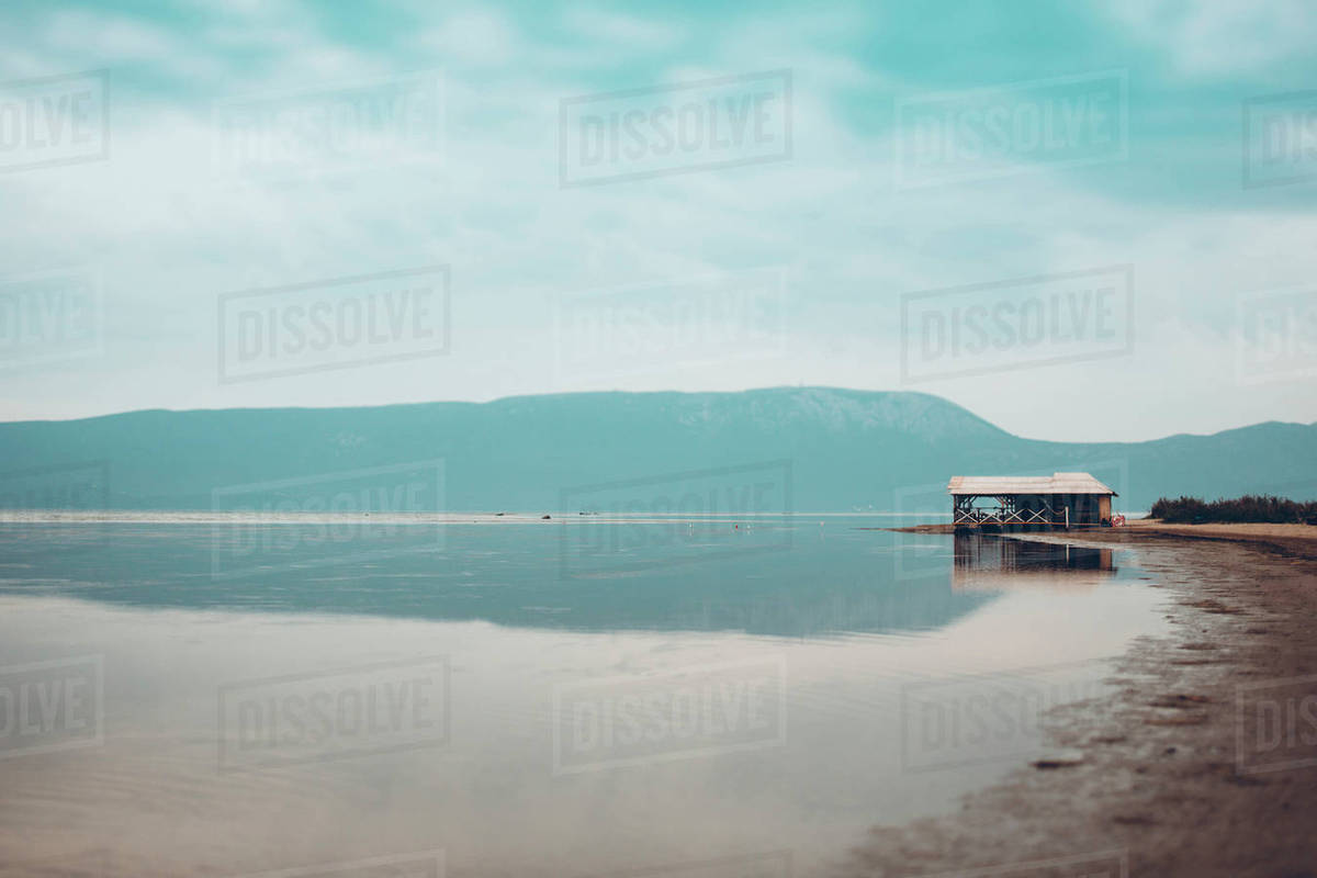 Mountain and cloudy sky reflecting on calm lake Royalty-free stock photo