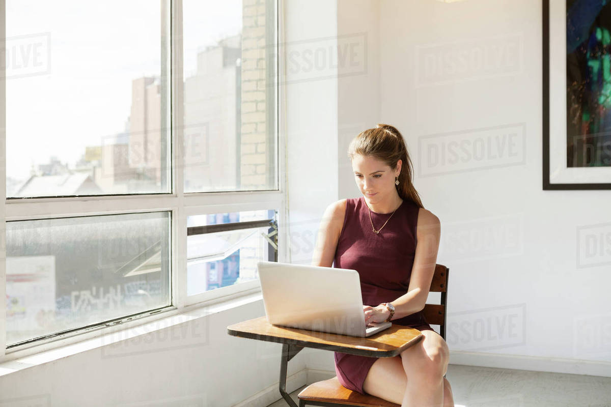 Young businesswoman using laptop on table in creative office Royalty-free stock photo
