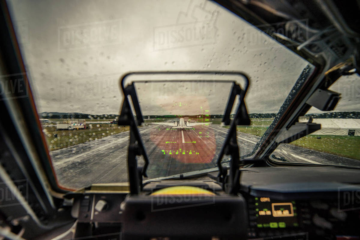 Airplane on runway against sky seen through wet windshield Royalty-free stock photo