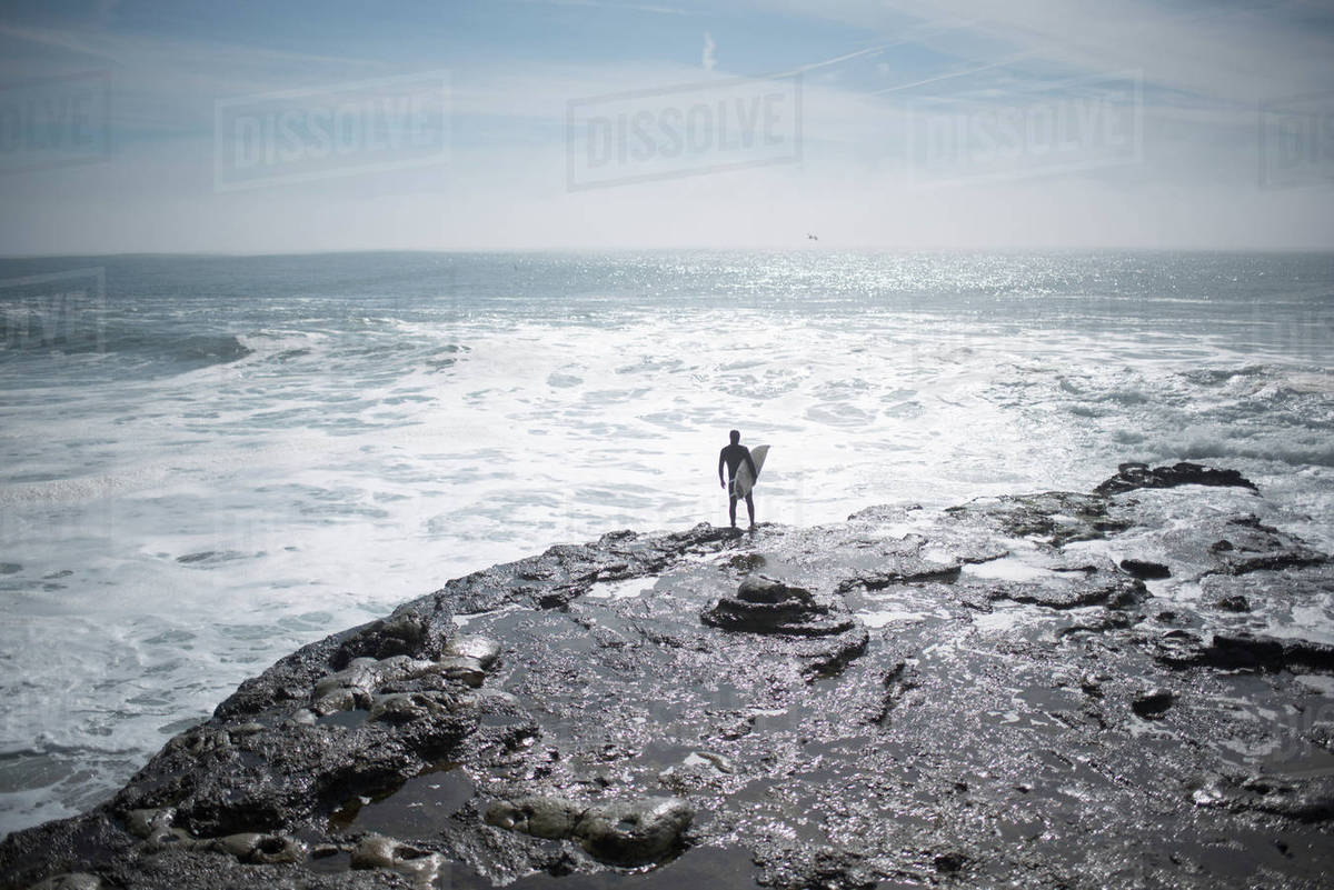 High angle view of man with surfboard at beach Royalty-free stock photo