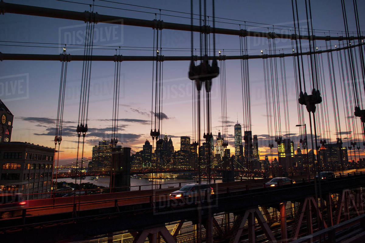 Cityscape against sky during sunset seen through Manhattan bridge Royalty-free stock photo