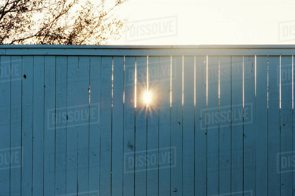 Sunlight emitting through wooden fence Royalty-free stock photo