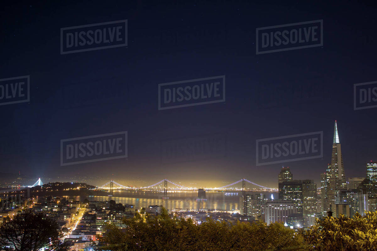 High angle view of illuminated bridge by city against clear sky at night Royalty-free stock photo
