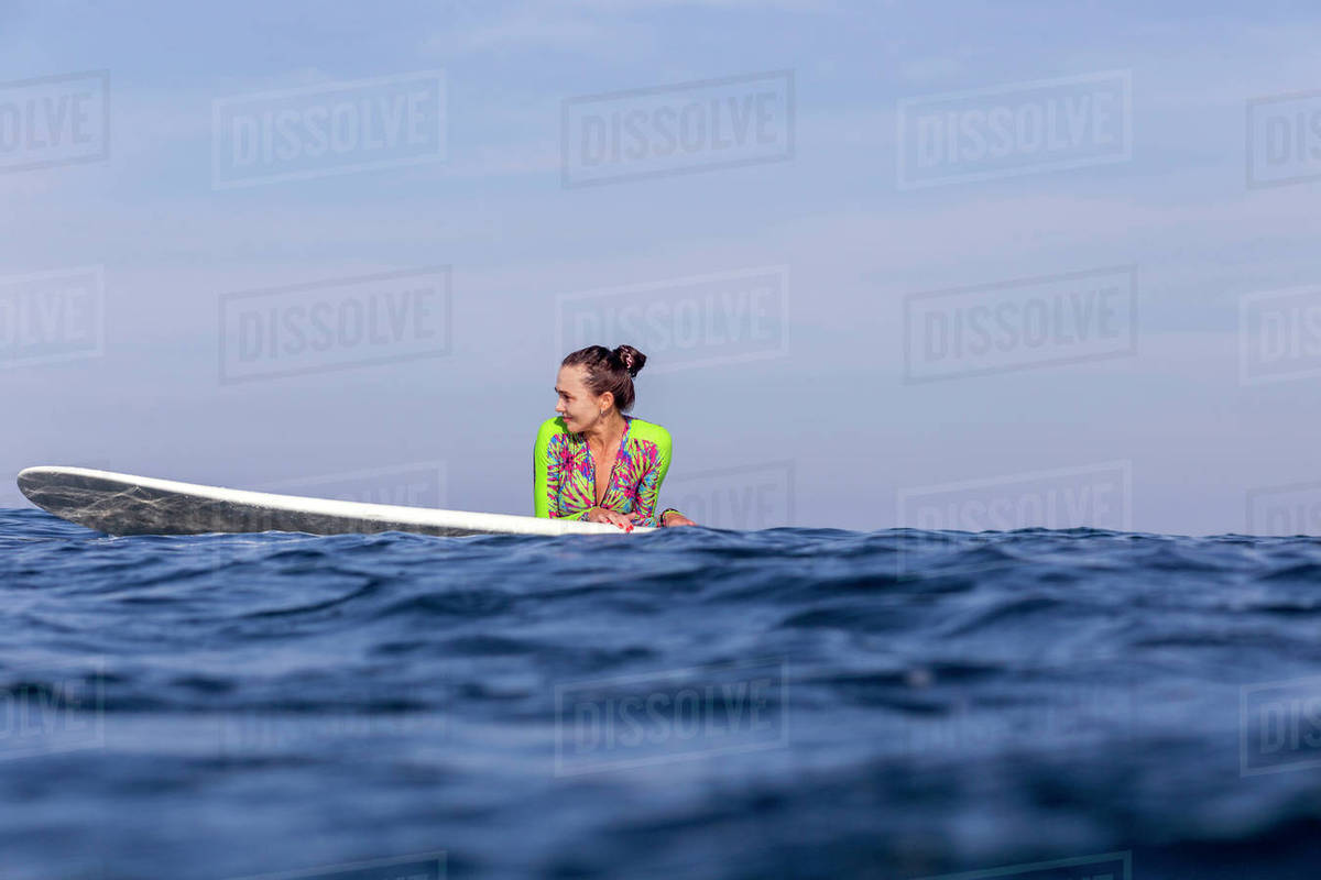 Woman with surfboard on sea against sky Royalty-free stock photo