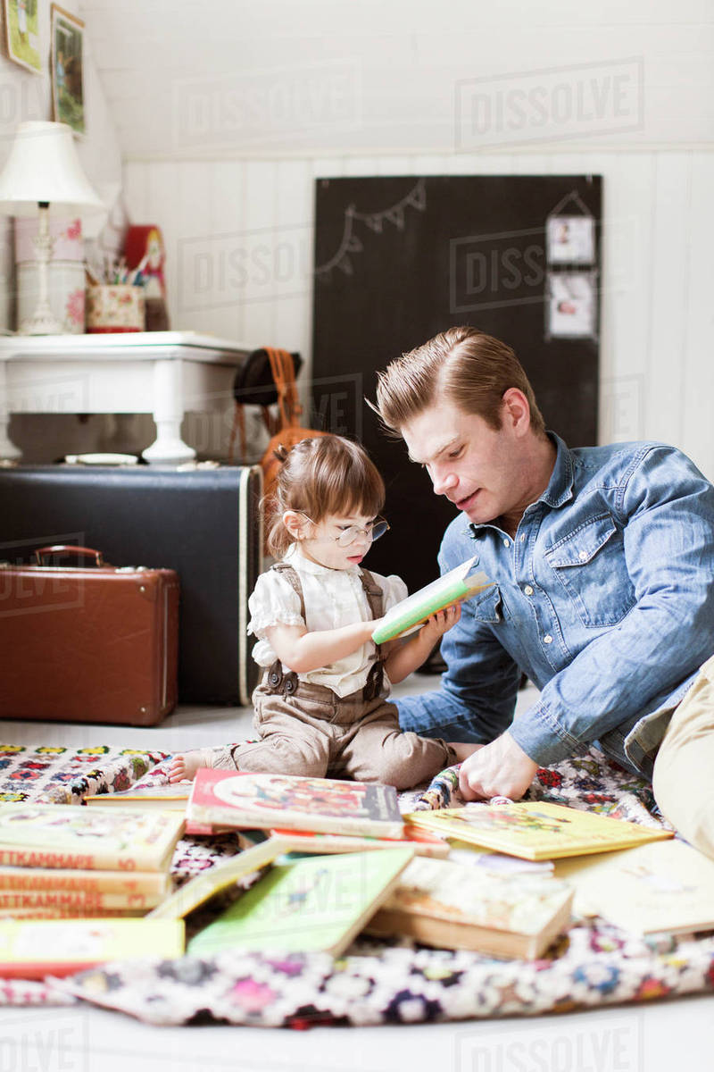 Sweden, Father reading with daughter (2-3) picture book Royalty-free stock photo