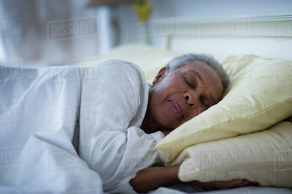 Black Woman Sleeping In Bed - Stock Photo - Dissolve-1836