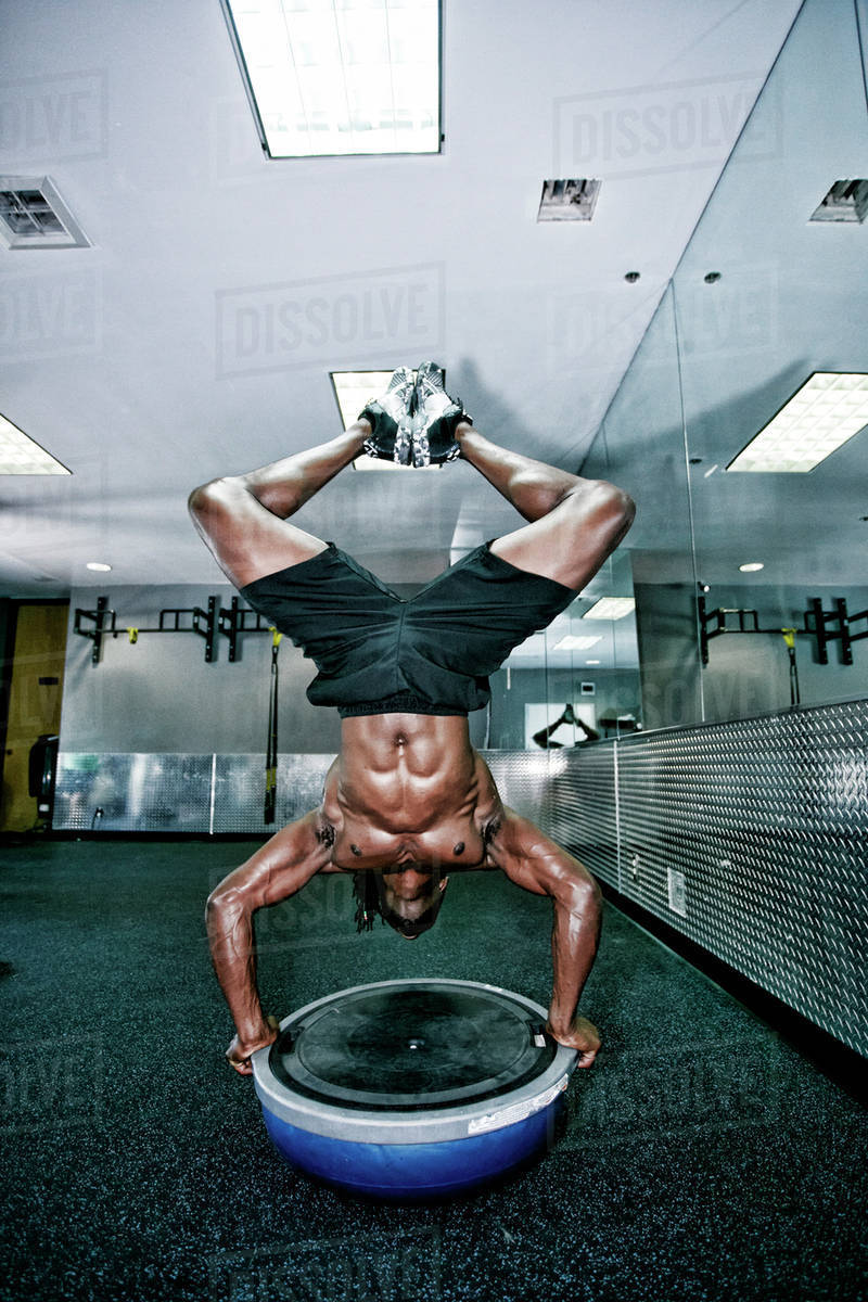 African American man doing handstand in gym Royalty-free stock photo