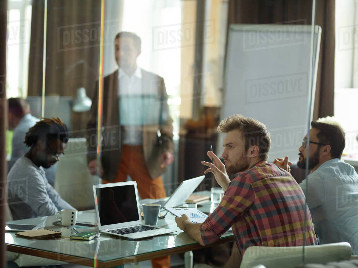 Briefing in young creative company among male workers Royalty-free stock photo