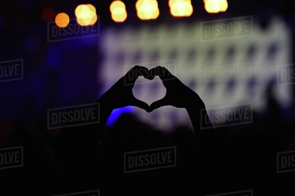 Close-up of heart shaped hands at concert Royalty-free stock photo