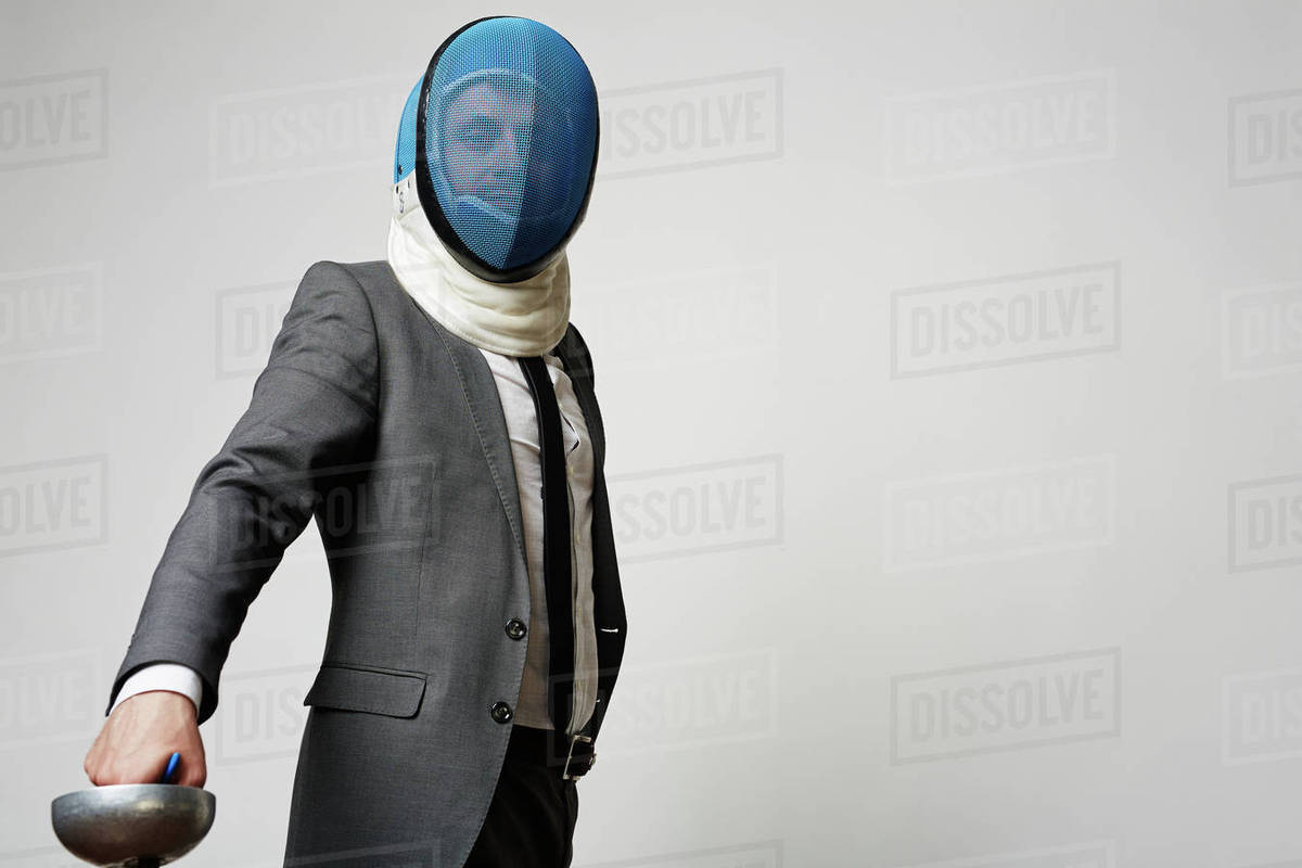 Portrait of businessman in mask and sword Royalty-free stock photo