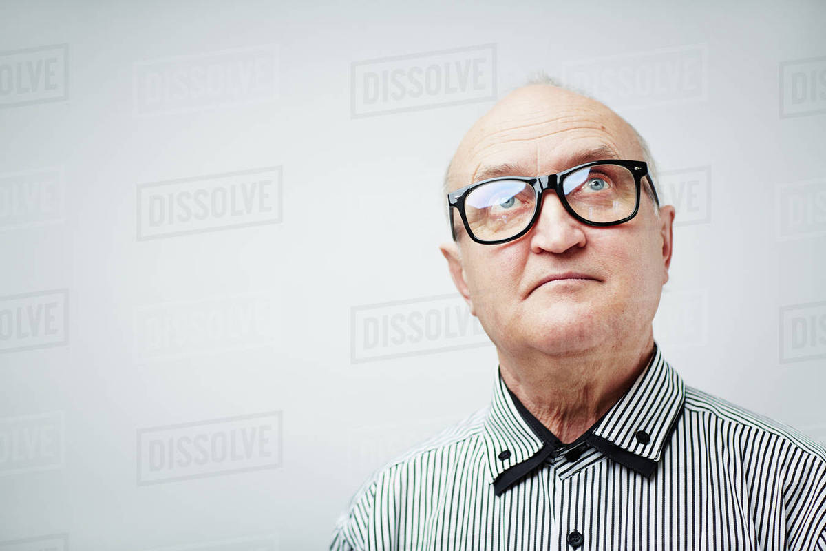 Portrait of senior man in glasses looking up Royalty-free stock photo