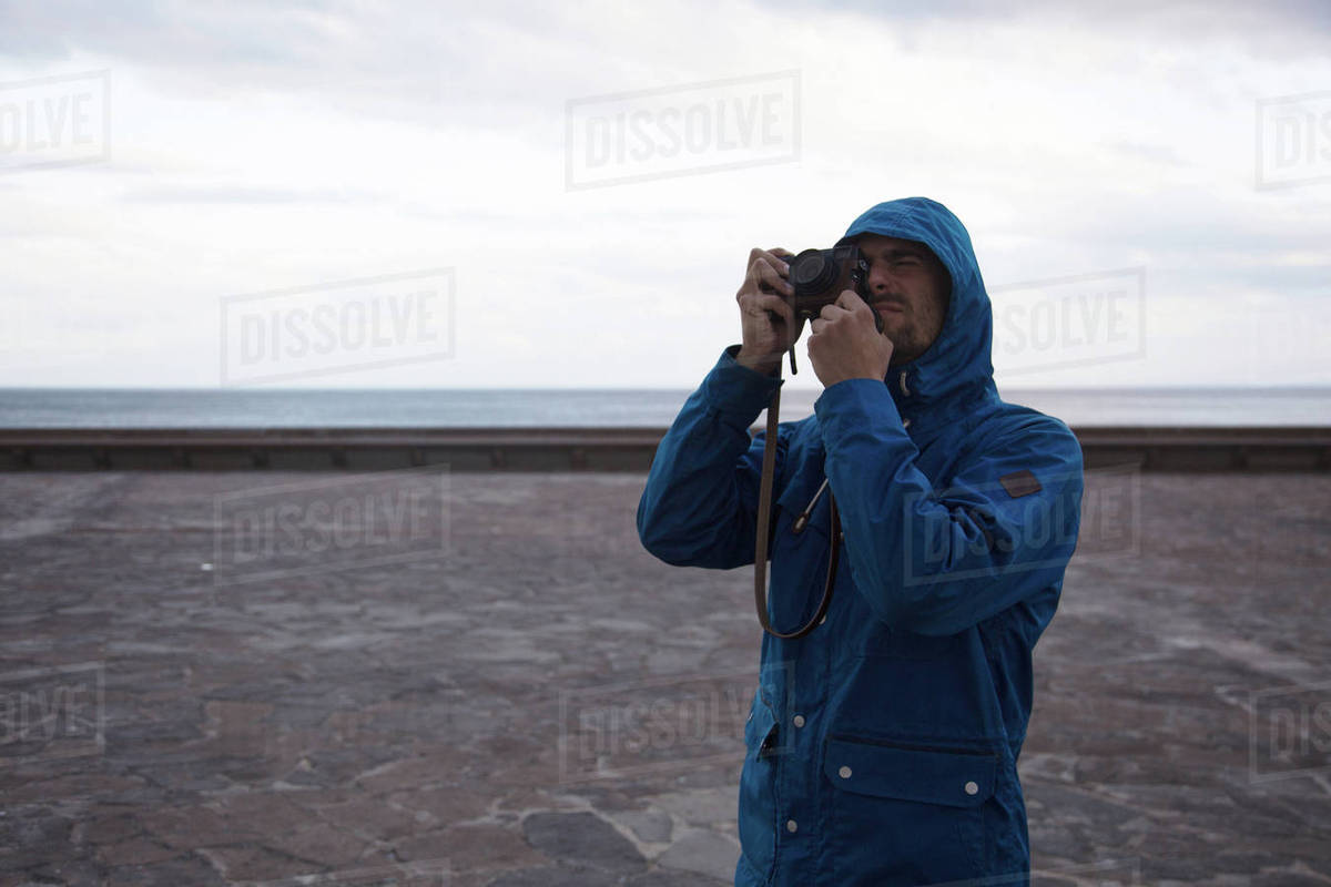Traveling man taking photos during journey Royalty-free stock photo