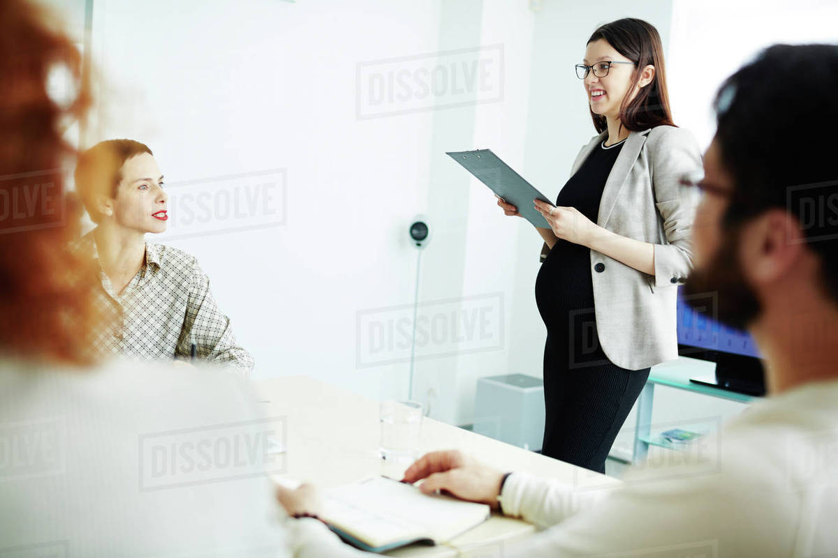 Happy managers listening to teacher at seminar Royalty-free stock photo