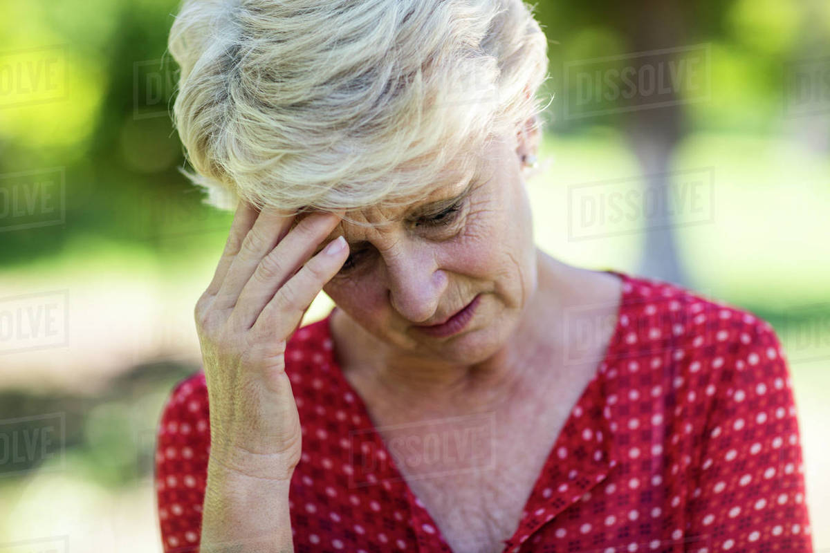 Close-up of a unhappy senior woman in park Royalty-free stock photo