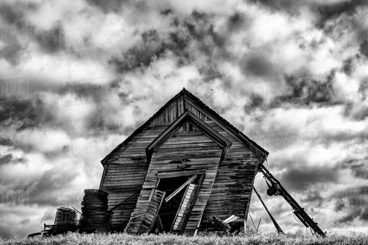 USA, Washington. Abandoned leaning schoolhouse in Palouse farm country. Rights-managed stock photo