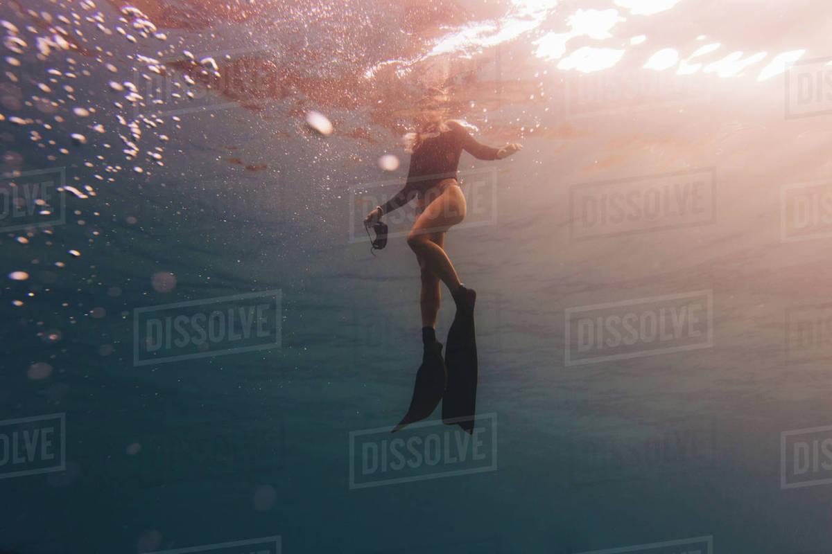 Woman treading water near surface of sea Royalty-free stock photo