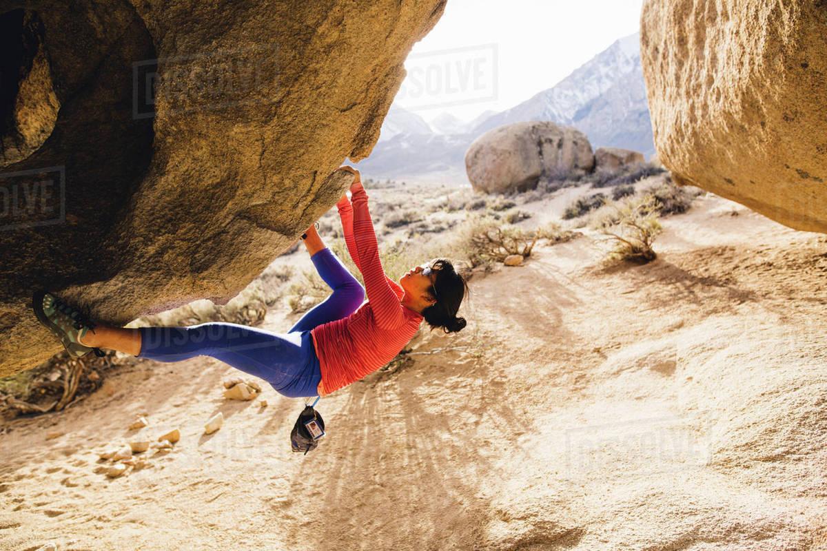 Woman rock climbing, Buttermilk Boulders, Bishop, California, USA Royalty-free stock photo