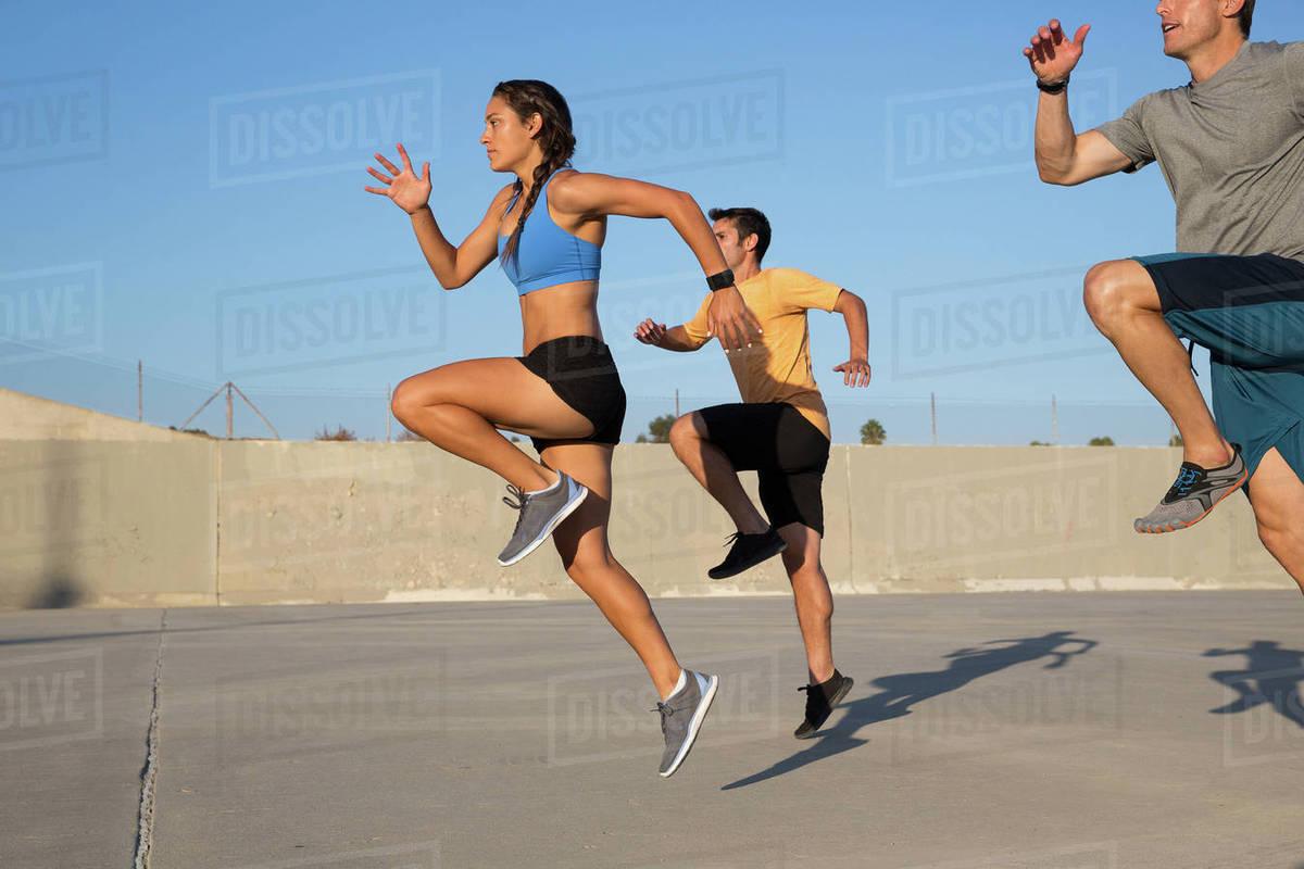 Athletes doing high knees exercise, Van Nuys, California, USA Royalty-free stock photo