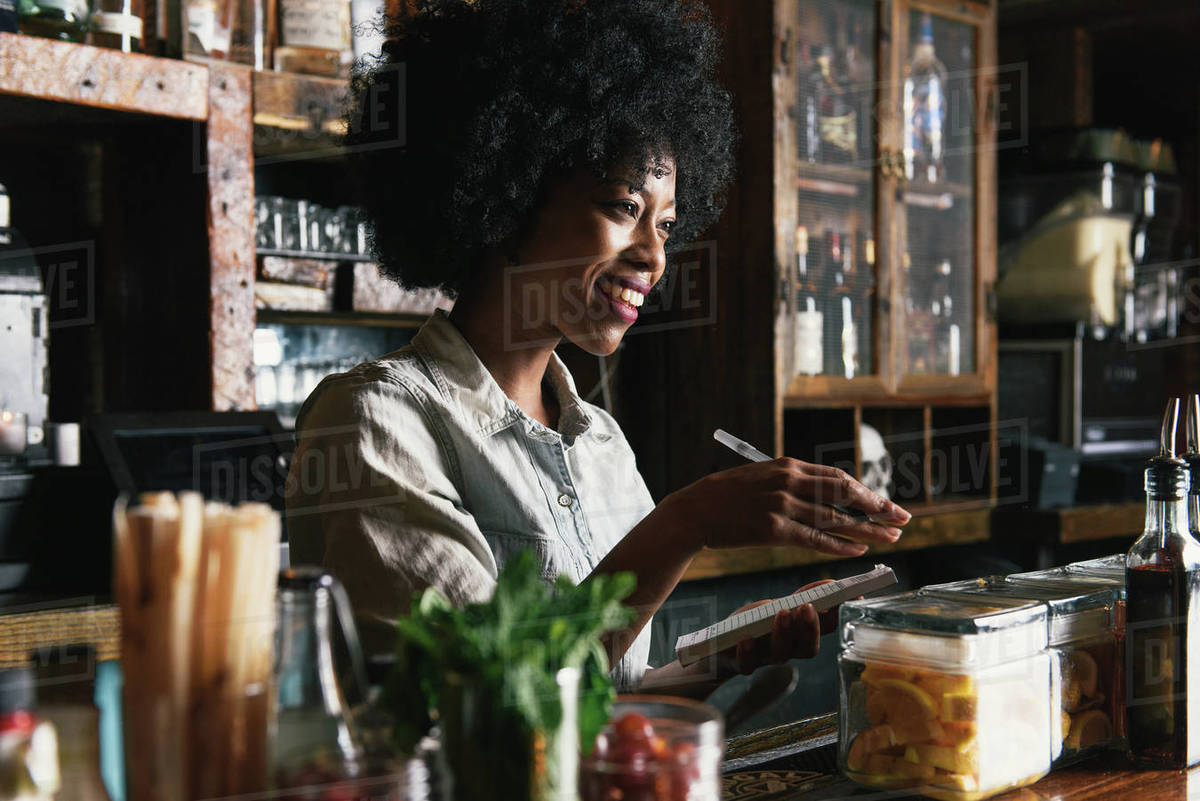 Bartender working behind bar in pub Royalty-free stock photo