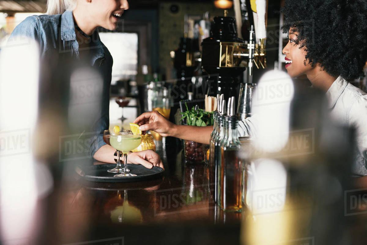 Bartender serving cocktails Royalty-free stock photo