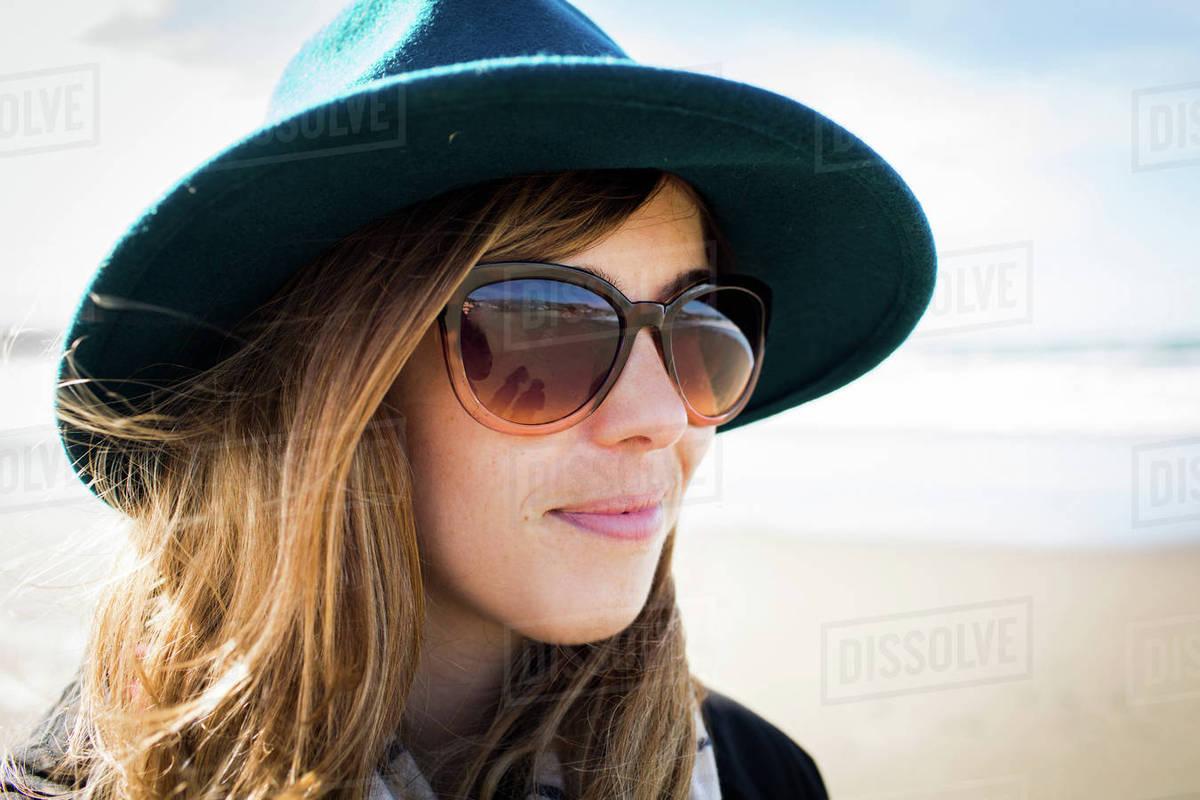 Portrait of stylish woman wearing felt hat and sunglasses, Dillon Beach, California, USA Royalty-free stock photo
