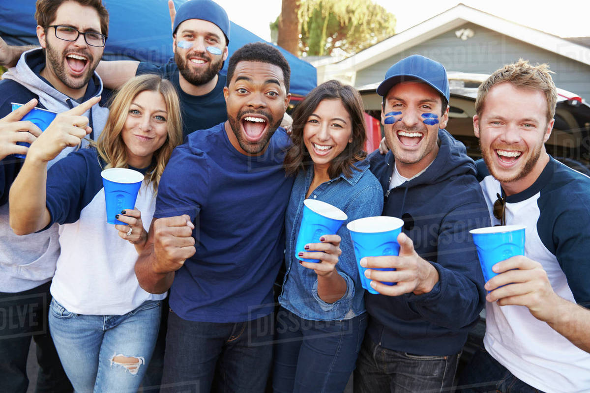 Group Of Sports Fans Tailgating In Stadium Car Park Royalty-free stock photo